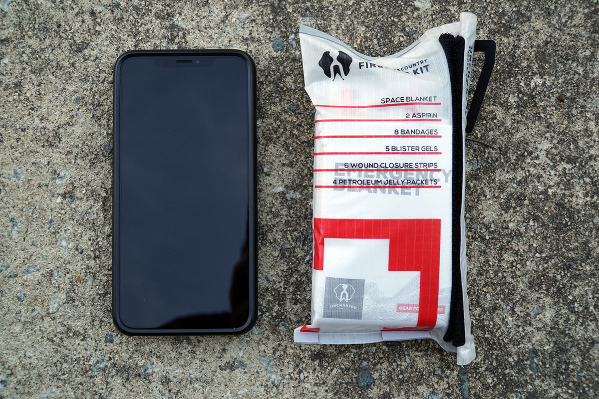 uncharted supply co triage kit pocket sized first aid kit held open to show contents