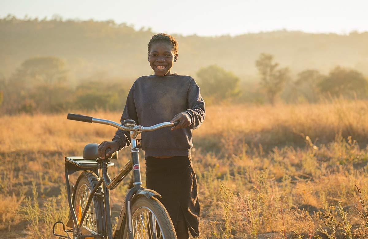 buffalo bike and kid as part of new vandoit social mission to donate bikes for every van sold