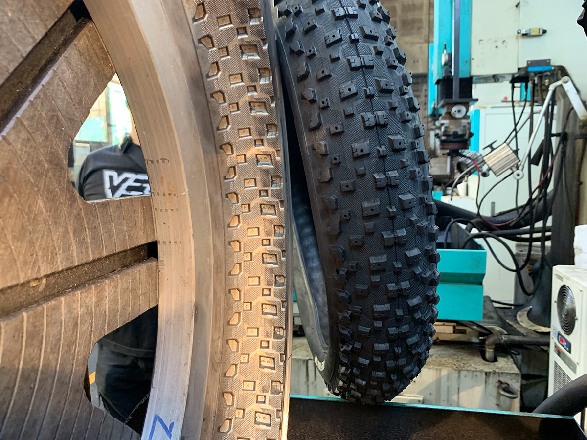 vee mountain bike tire next to the mold used to make it