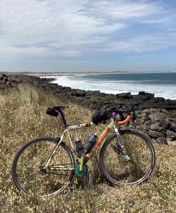 bikerumor pic of the day a bicycle in the foreground is among the grasses overlooking a rocky shoreline in barwon heads australia.