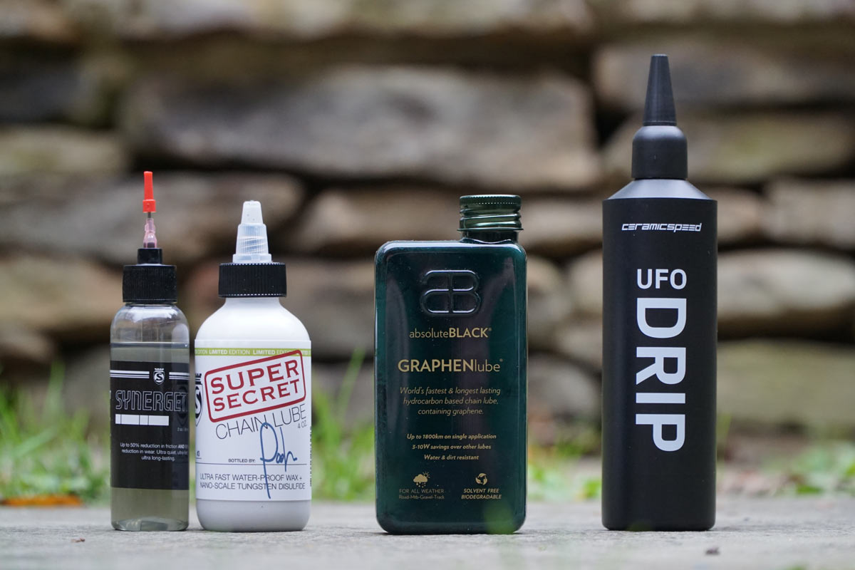 the best wax chain lubes for cyclists - silca super secret chain lube - absoluteblack graphenlube - ceramicspeed ufo drip