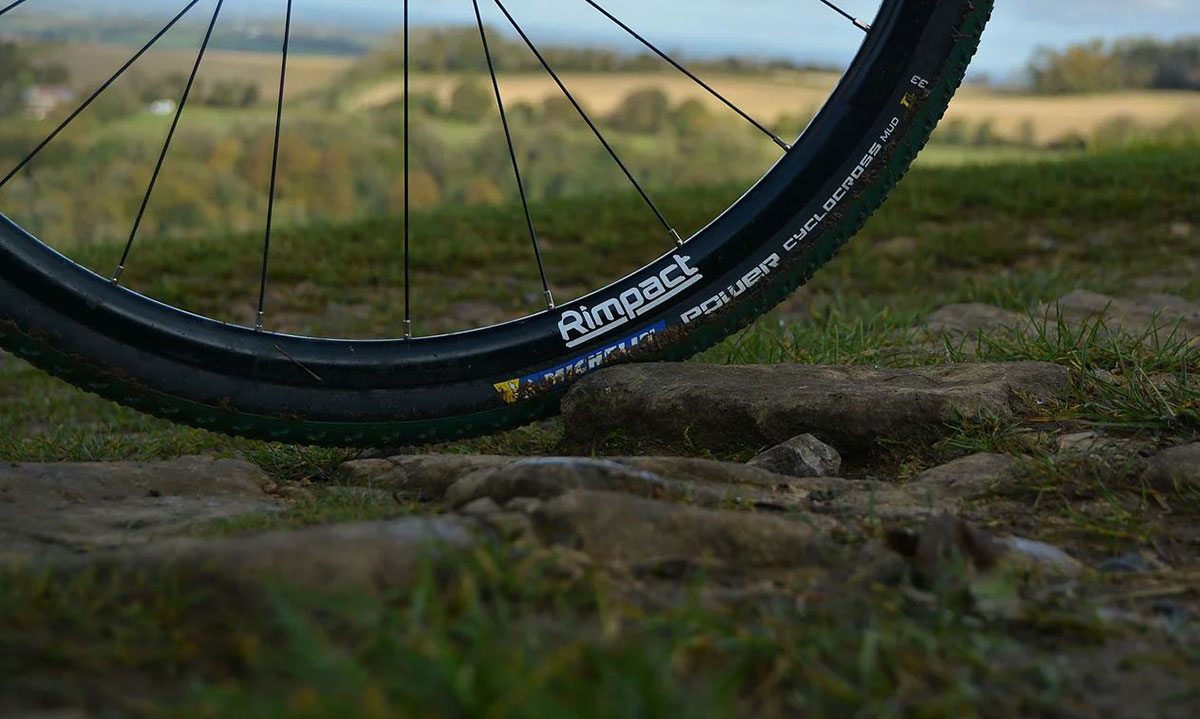 rimpact tire insert for cyclocross racing on clincher tires offers rim protection vibrtion damping anti-pinch flat