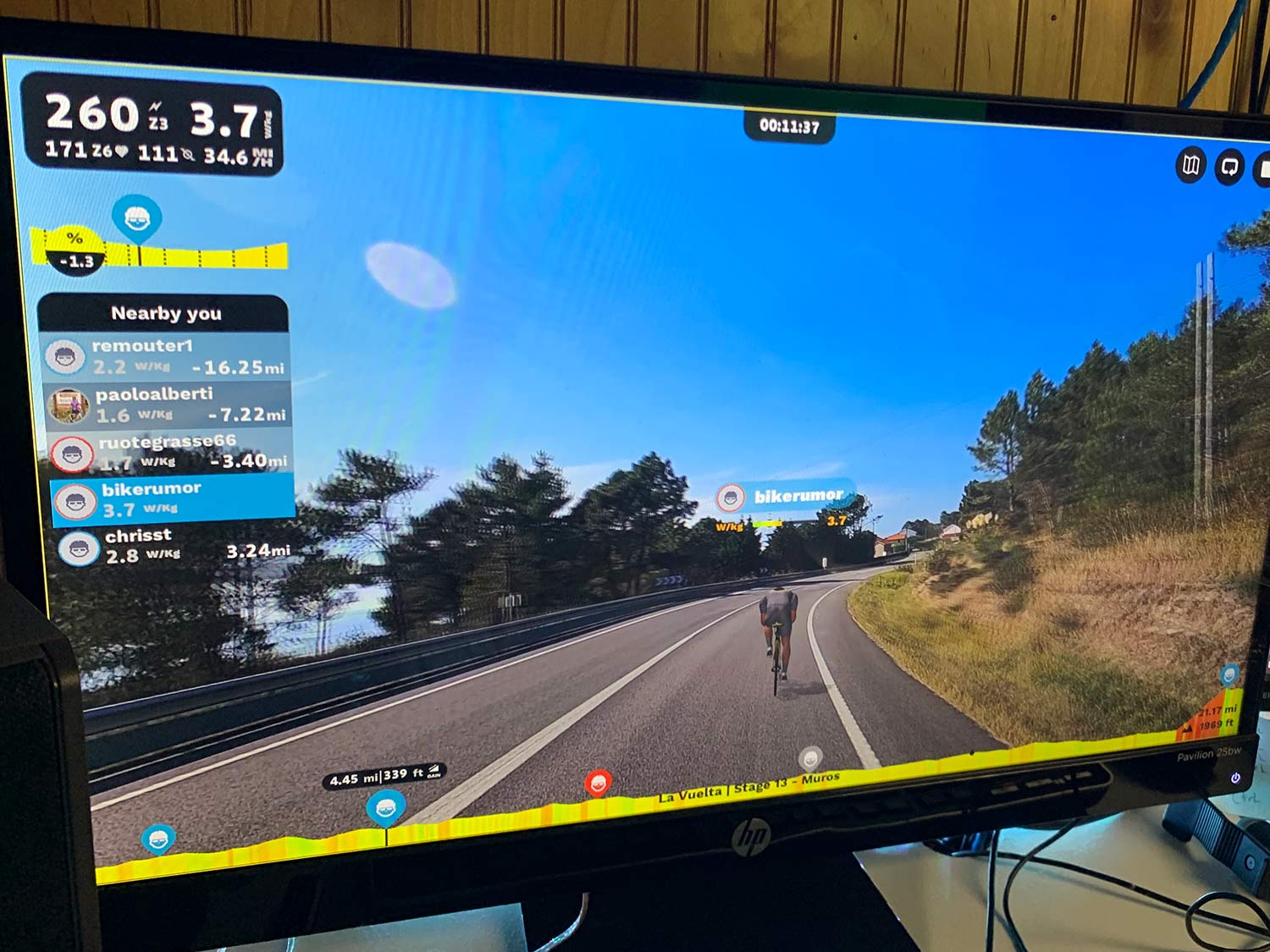 rouvy indoor virtual cycling training app screenshot showing rider stats and position