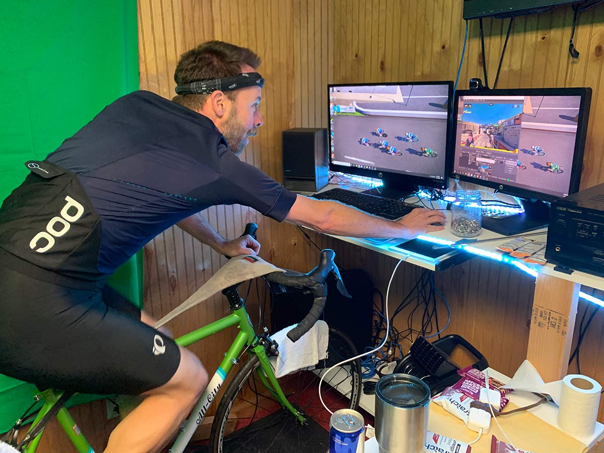 rider setting up rouvy indoor cycling app on home computer for cycling training inside