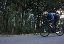2021 specialized aethos pro lightweight road bike review and action riding photo