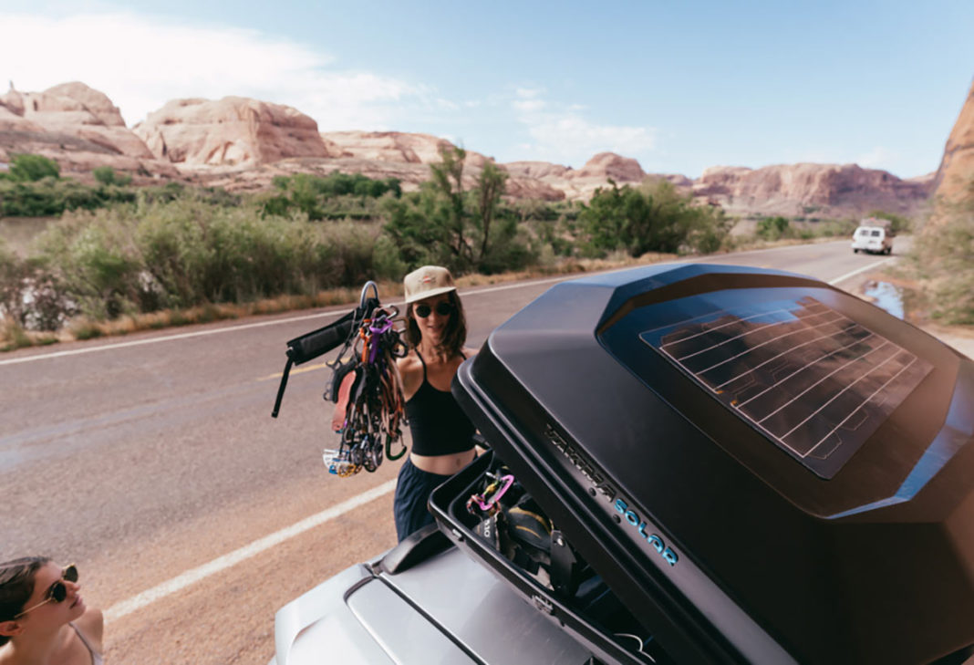 yakima CBX solar rooftop cargo box with solar panel mounted to vehicle