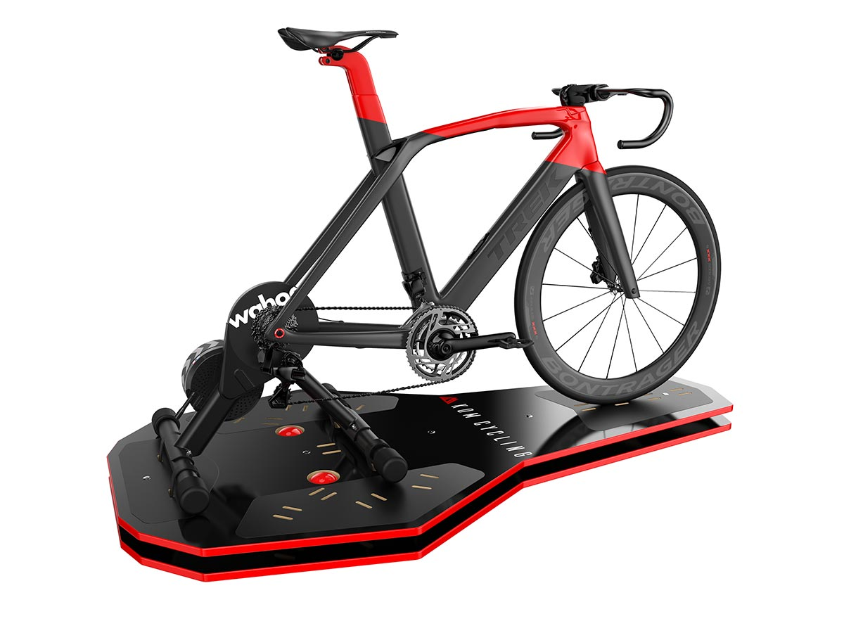 kom cycling rocker plate indoor trainer platform with trek road bike mounted to wahoo fitness kickr smart trainer