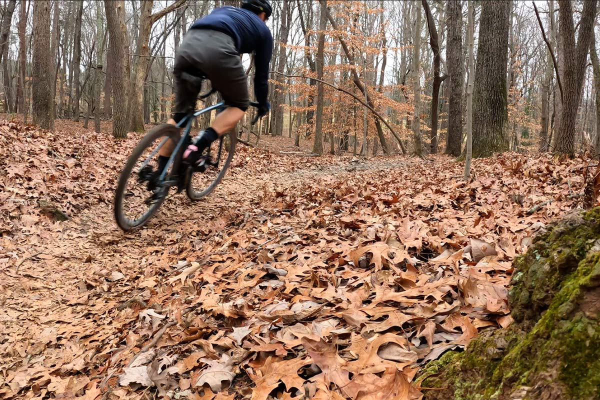 zipp tangente course gravel tire review showing tires gripping leaf covered ground