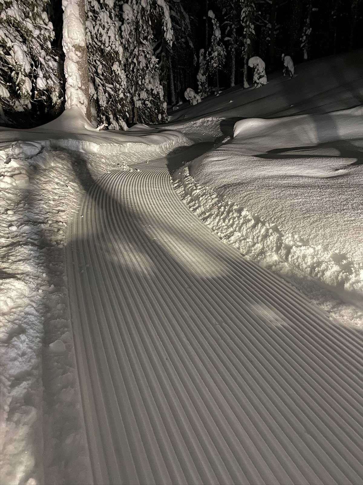 trailander bike route plane smooths snow covered mountain bike trails for fat biking