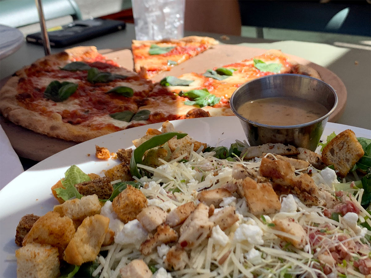 pizza and salad from pedalers pub in bentonville Arkansas
