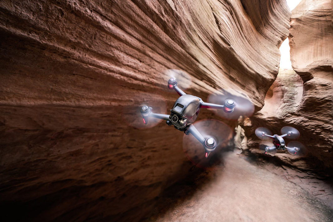 dji fpv drone flying in a canyon